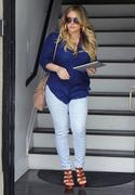 http://img218.imagevenue.com/loc1124/th_331299751_Hilary_Duff_at_hair_salon_in_Beverly_Hills17_122_1124lo.jpg
